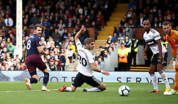 File photo dated 07-10-2018 of Arsenal's Aaron Ramsey (left) scores his side's third goal of the game against Fulham during the Premier League match at Craven Cottage, London.