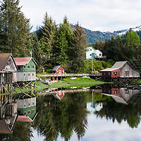 Homes and fishing sheds are reflected in a pond in Petersburg, a fishing village in Southeast Alaska known as Little Norway.