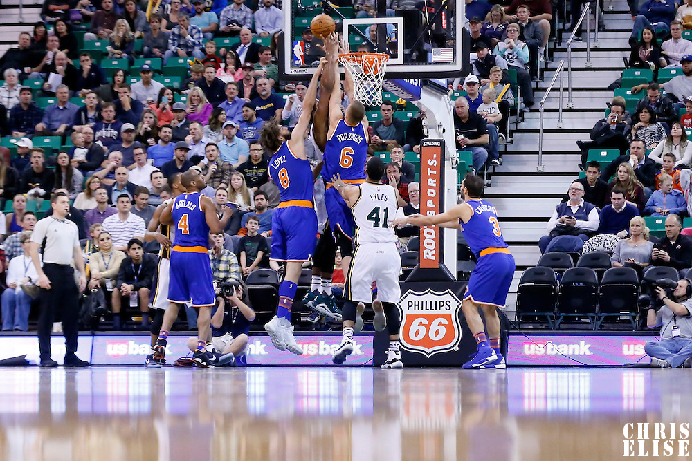 09 December 2015: New York Knicks forward Kristaps Porzingis (6) blocks Utah Jazz forward Derrick Favors (15) during the Utah Jazz 106-85 victory over the New York Knicks, at the Vivint Smart Home Arena, Salt Lake City, Utah, USA.