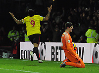 Football - 2017 / 2018 Premier League - Watford vs. Chelsea<br /> <br /> Troy Deeney of watford turns away to celebrate his Penalty kick goal with goalkeeper,Thibaut Courtois on his knees, at Vicarage Road.<br /> <br /> COLORSPORT/ANDREW COWIE