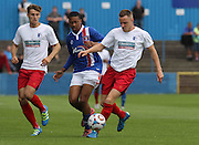 Liam Hughes battles with Reggie Lamb during the Pre-Season Friendly match between Barrow and Carlisle United at Holker Street, Barrow, United Kingdom on 23 July 2016. Photo by Pete Burns.