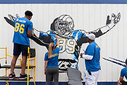 Los Angeles Rams tight end Kendall Blanton (86) paints a mural of defensive tackle Aaron Donald (99) during community improvement project at Belvedere Elementary School to upgrade play and social spaces around the school by building a new playground structure, painting murals and basketball backboards and landscaping., Friday, June 14, 2019, in Los Angeles, Calif. (Ed Ruvalcaba/Image of Sport)