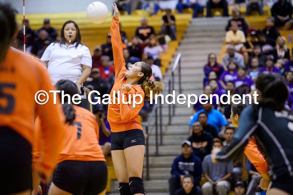 Gallup Bengal Jordan Joe (5) spikes the ball at the Miyamura Patriots Thursday at Gallup High School.