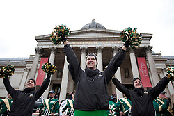© Licensed to London News Pictures. 30/12/2012. London, UK. Members of the 'Herd of Thunder', the marching band of the University of South Florida USA, are seen performing with their cheerleaders in Trafalgar Square today (30/12/12) as part of a preview for London's 2012 New Years Day Parade. The parade, featuring more than 6000 performers, is set to take place on the New Year's Day, the 1st of January 2013, in the West End of London. Photo credit: Matt Cetti-Roberts/LNP