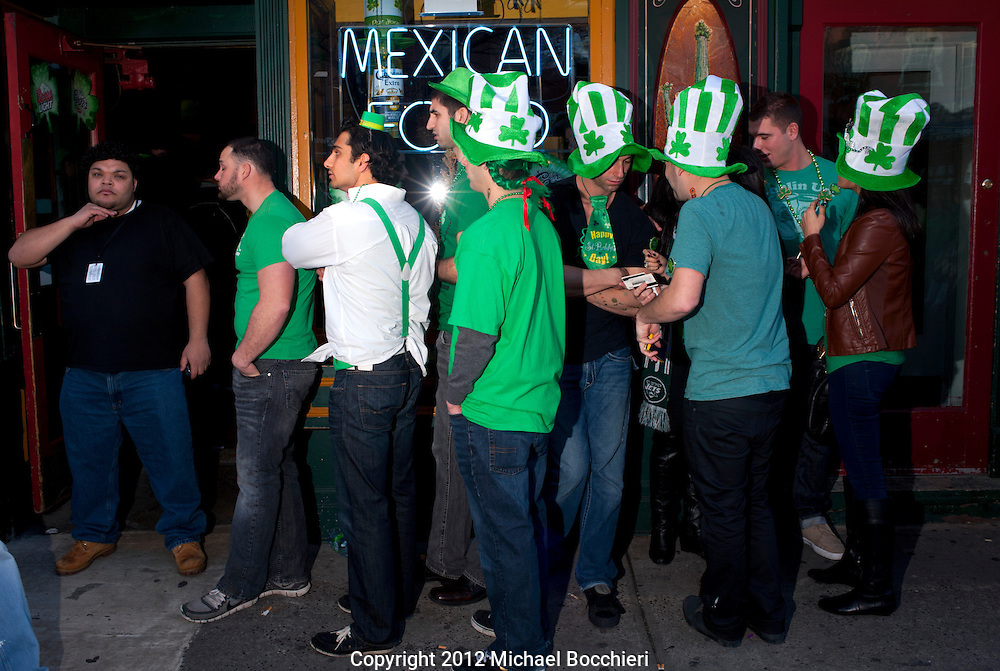 HOBOKEN, NJ - MARCH 03:  People wait online at a bar to attend the Lepre-Con event as part of St. Patrick's Day festivites March 03, 2012 in Hoboken, New Jersey. Following the city's cancelation of the annual St. Patrick's Day Parade organizers held a city-wide drinking event that attracted thousands to the area.  (Photo by Michael Bocchieri/Bocchieri Archive)
