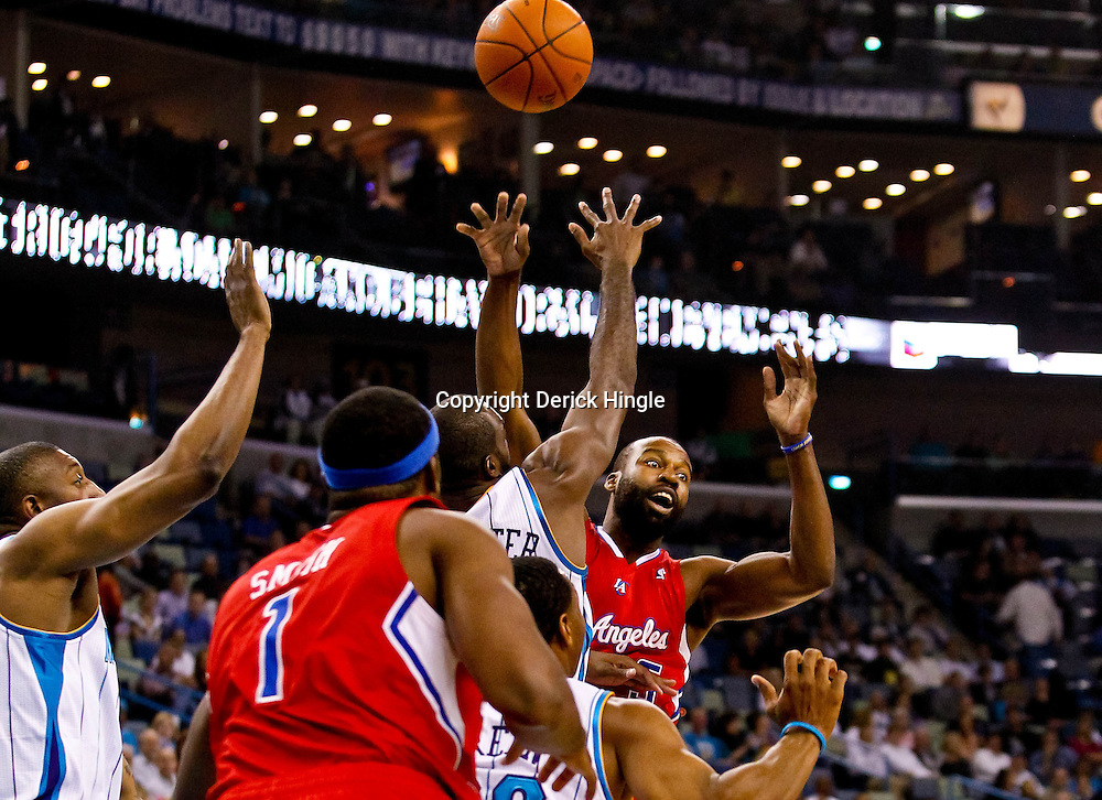 November 9, 2010; New Orleans, LA, USA; Los Angeles Clippers point guard Baron Davis (5) passes the ball as New Orleans Hornets small forward Quincy Pondexter (20) defends during the first half at the New Orleans Arena. Mandatory Credit: Derick E. Hingle