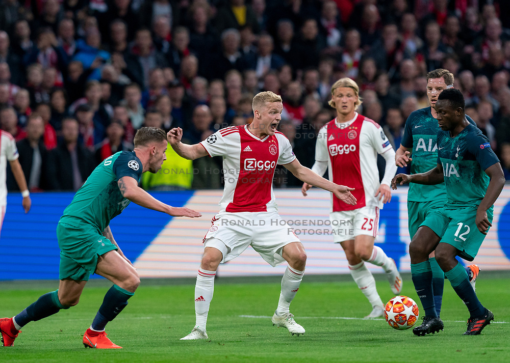 08-05-2019 NED: Semi Final Champions League AFC Ajax - Tottenham Hotspur, Amsterdam<br /> After a dramatic ending, Ajax has not been able to reach the final of the Champions League. In the final second Tottenham Hotspur scored 3-2 / Donny van de Beek #6 of Ajax, Toby Alderweireld #4 of Tottenham Hotspur, Victor Wanyama #12 of Tottenham Hotspur