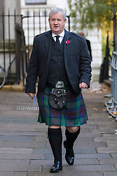 © Licensed to London News Pictures. 10/11/2019. London, UK. Ian Blackford, Leader of the Scottish National Party in Westminster walks through Downing Street wearing a kilt to attend the Remembrance Sunday Ceremony at the Cenotaph in Whitehall. Remembrance Sunday events are held across the country today as the UK remembers and honours those who have sacrificed themselves in two world wars and other conflicts. Photo credit: Vickie Flores/LNP