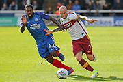 Peterborough United midfielder Anthony Grant and Bradford City midfielder Romain Vincelot  battle it out for the ball during the EFL Sky Bet League 1 match between Peterborough United and Bradford City at London Road, Peterborough, England on 9 September 2017. Photo by Aaron  Lupton.