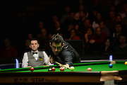 19.02.2016. Cardiff Arena, Cardiff, Wales. Bet Victor Welsh Open Snooker. Mark Selby versus Ronnie O'Sullivan. Ronnie O'Sullivan pots the pink with Mark Selby watching on.