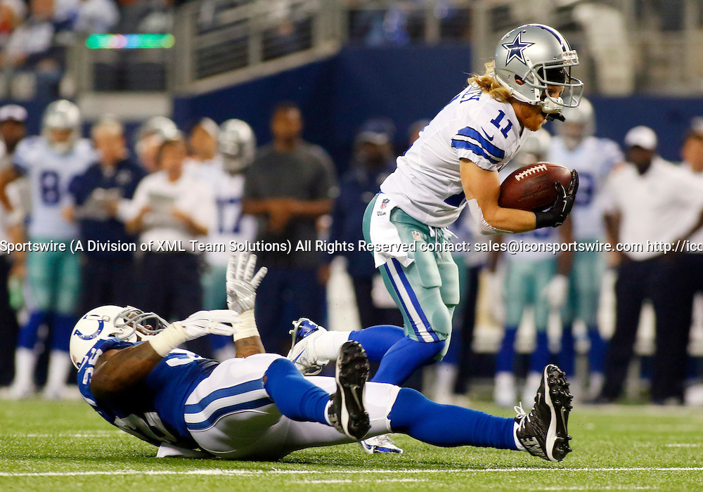 21 DEC 2014: Dallas Cowboys Wide Receiver Cole Beasley (11) [18238] makes the catch and eventually breaks the tackle of Indianapolis Colts Linebacker D'Qwell Jackson (52) [8581]  for a 24-yard TD during an NFL regular season game between the Indianapolis Colts and Dallas Cowboys at AT&T Stadium in Arlington, TX.