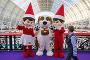 UNITED KINGDOM, London: 22 January 2019. Beau Koster, aged 10, walks past actors in character clothing as they pose for a picture at The Toy Fair 2019 being held at Olympia London this morning. The Toy Fair, which runs between 22nd-24th of January, is the UK's largest toy trade event with over 250 exhibiting companies launching thousands of new products. <br /> Rick Findler / Story Picture Agency