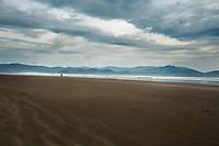 Surfer on Inch Beach, outside Dingle, Ireland. Copyright 2019 Reid McNally.