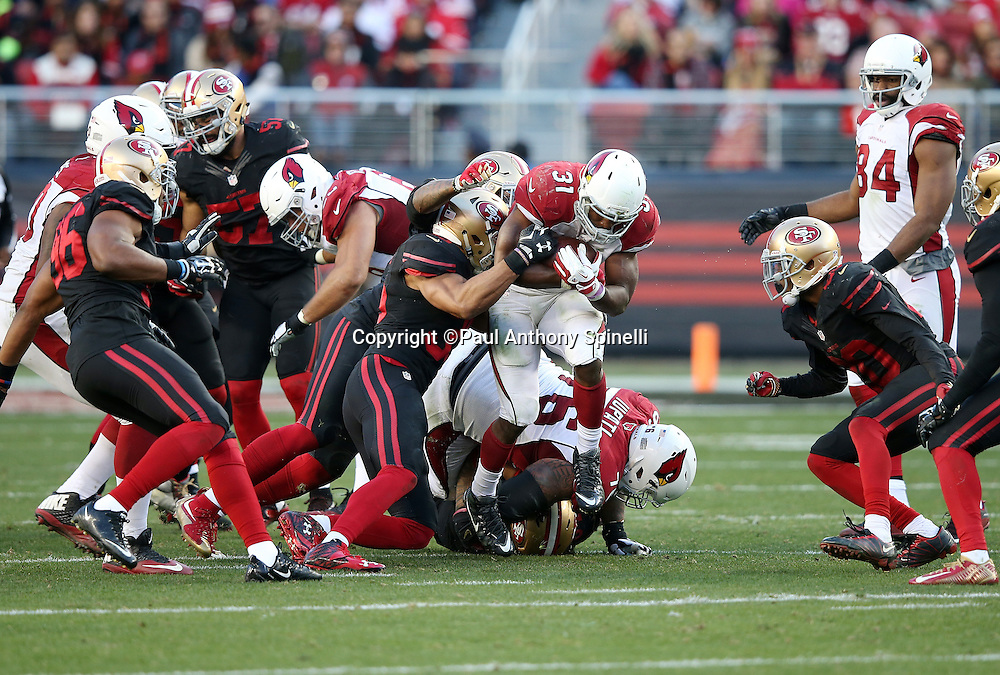 Arizona Cardinals running back and kick returner David Johnson (31) gets tackled as he runs the ball during the 2015 week 12 regular season NFL football game against the San Francisco 49ers on Sunday, Nov. 29, 2015 in Santa Clara, Calif. The Cardinals won the game 19-13. (©Paul Anthony Spinelli)