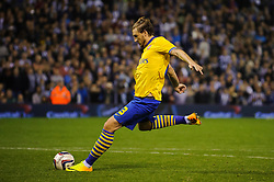 Arsenal Forward Nicklas Bendtner (DEN) strikes Arsenal shot during Arsenal penalty shootout - Photo mandatory by-line: Rogan Thomson/JMP - Tel: 07966 386802 - 25/09/2013 - SPORT - FOOTBALL - The Hawthorns - West Bromwich Albion v Arsenal - Capital One Cup Round 3.