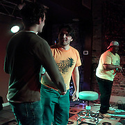 Zach Pappas, left Brett J. Young, center and Brick Jackson perform during Pineapple Shaped Lamps' premiere party for Sketch 22, a show that airs on the Cape Fear CW. (Jason A. Frizzelle)