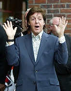 Former Beatle Paul McCartney greets fans. (AP Photo/John Froschauer)
