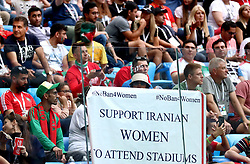 Fans in the stands hold up a banner in support of Iranian Women who are banned from attending matches in their home country