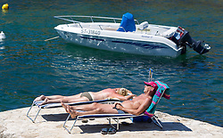 THEMENBILD - URLAUB IN KROATIEN, ein Touristen Paar beim Sonnen, aufgenommen am 03.07.2014 in Vrsar, Kroatien // a tourist couple enjoying the sun near Vrsar, Croatia on 2014/07/03. EXPA Pictures © 2014, PhotoCredit: EXPA/ JFK