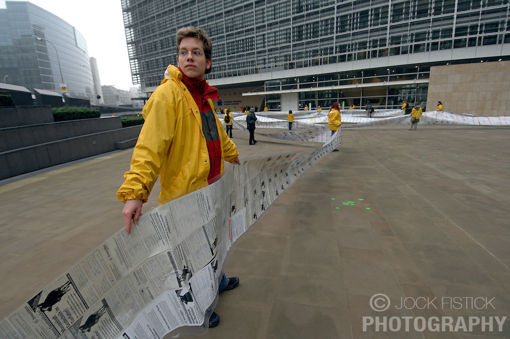 BRUSSELS, BELGIUM - FEB-5-2007 - Greenpeace activists stretched a petition containing one million signatures around the European Commission headquarters in Brussels, in protest of the use of GMO's in animal feed. A loop hole in European law allows for this practice which Greenpeace is trying to stop. Marco Contiero, Greenpeace Policy Advisor on GMO's along with other Greenpeace representatives later held a press conference with Markos Kyprianou, EU Commissioner for Health and presented him with a slimmed down version of the petition. (PHOTO  © JOCK FISTICK)