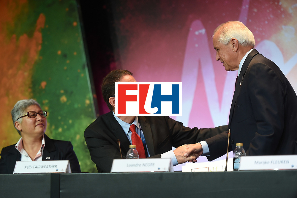 DUBAI, UNITED ARAB EMIRATES - NOVEMBER 12:  Leandro Negre (R) and Kelly Fairweather, CEO of International Hockey Federation (L) shake hands during the 45th FIH Congress on November 12, 2016 in Dubai, United Arab Emirates.  (Photo by Tom Dulat/Getty Images)