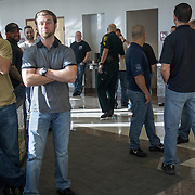 FORT LAUDERDALE, FLORIDA, DECEMBER 21, 2015<br /> Supporters of suspended Broward Sheriff's deputy Peter Peraza, mostly plain clothes and some uniformed police officers, wait for the deputy's arrival outside the courtroom. This was before a brief court appearance by Peraza and his criminal defense attorney. Peraza faces manslaughter charges in the shooting death of Jermaine McBean, 33, in July of 2013.<br /> (Photo by Angel Valentin/Freelance).