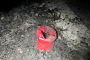 "A Trump hat in a pile of ash outside DeploraBall at the National Press Club in Washington D.C. during inauguration week. Trump supporter Dave Riley said ""someone grabbed my hat and ran, it was 4 or 5 protesters. I was blocked. Next thing I know it was in the fire"""