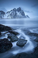 Stokksnes beach in winter twilight. Mount Vestahorn in background. Southeast Iceland.
