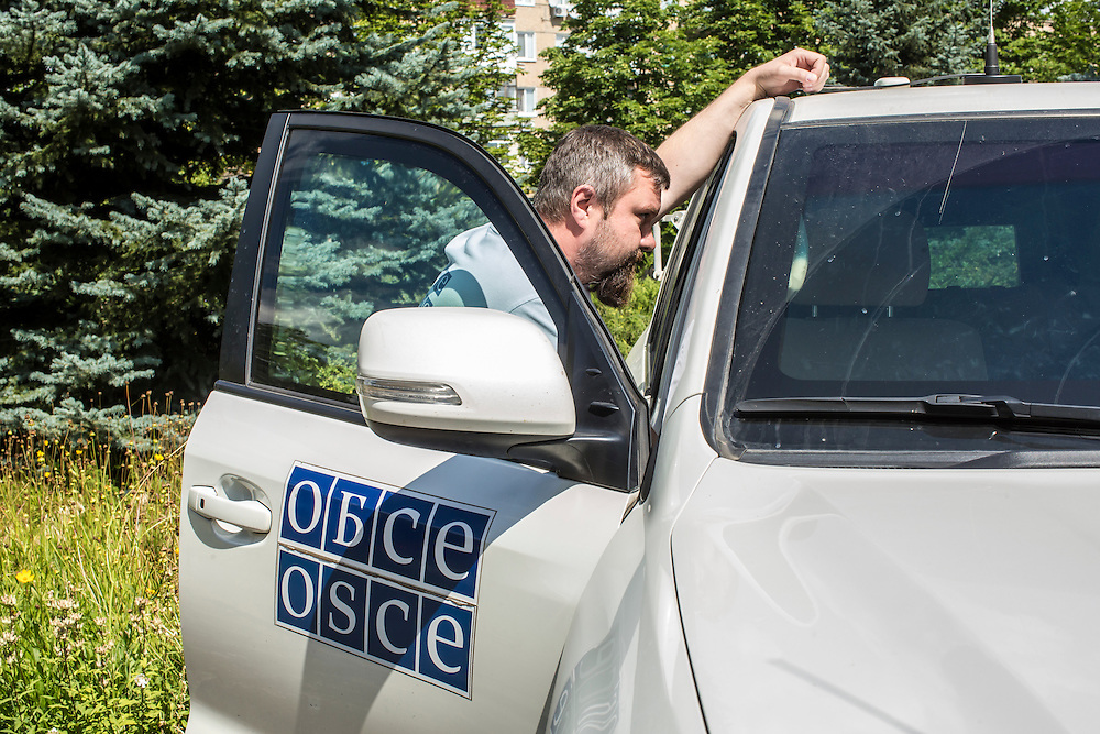 SVITLODARSK, UKRAINE - JULY 9, 2016: OSCE monitoring team patrol leader Piotr Szczepaniak from Poland with one of the mission's armored vehicles at their forward patrol base in Svitlodarsk, Ukraine. The mission tracks violations of the Minsk-II ceasefire agreement, among other tasks. CREDIT: Brendan Hoffman for The New York Times