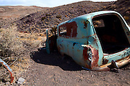 An old car sits abandoned near a mine site in Death Valley National Park.