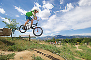 Tyler Trueman of San Antonio (TX) rides the Slopestyle track at the popular Valmont Bike Park in Boulder, CO. © Brett Wilhelm