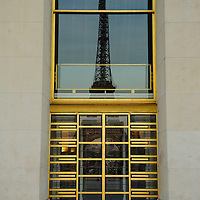 The Eiffel Tower is seen in a entrance reflection in Paris, France, in April, 2015.
