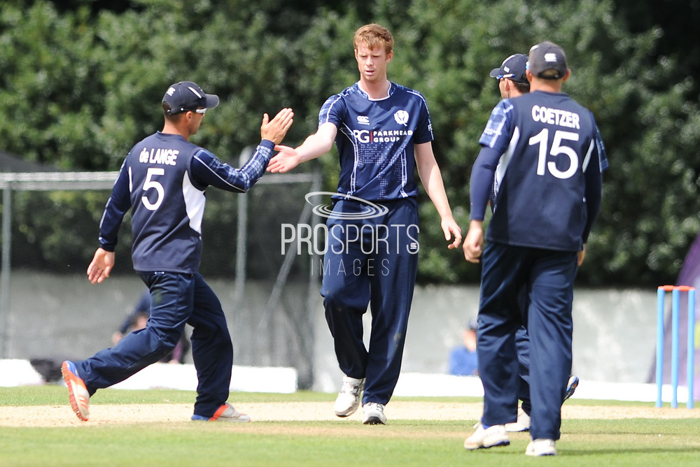 Con de Lange rushes to congratulate Alasdair Evans after bowling out Viljoen during the World Cricket League match between scotland and Namibia at Grange Cricket Club, Edinburgh, Scotland on 13 June 2017. Photo by Kevin Murray.