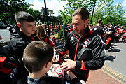 AFC Bournemouth midfielder Dan Gosling signing his autograph for a fan on arrival for the Premier League match between Bournemouth and Burnley at the Vitality Stadium, Bournemouth, England on 13 May 2017. Photo by Graham Hunt.