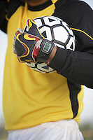 Soccer Goal Holding Soccer Ball