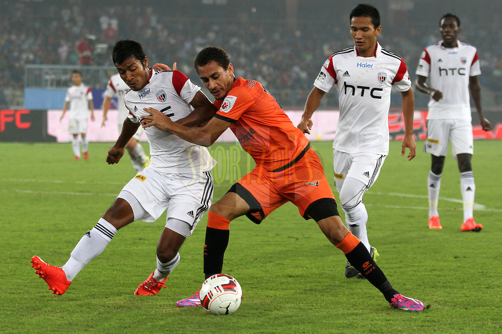 Gustavo Marmentini dos Santos of Delhi Dynamos FC trying to chase the ball during match 16 of the Hero Indian Super League between The Delhi Dynamos FC and NorthEast United FC held at the Jawaharlal Nehru Stadium, Delhi, India on the 29th October 2014.Photo by:  Deepak Malik/ ISL/ SPORTZPICS