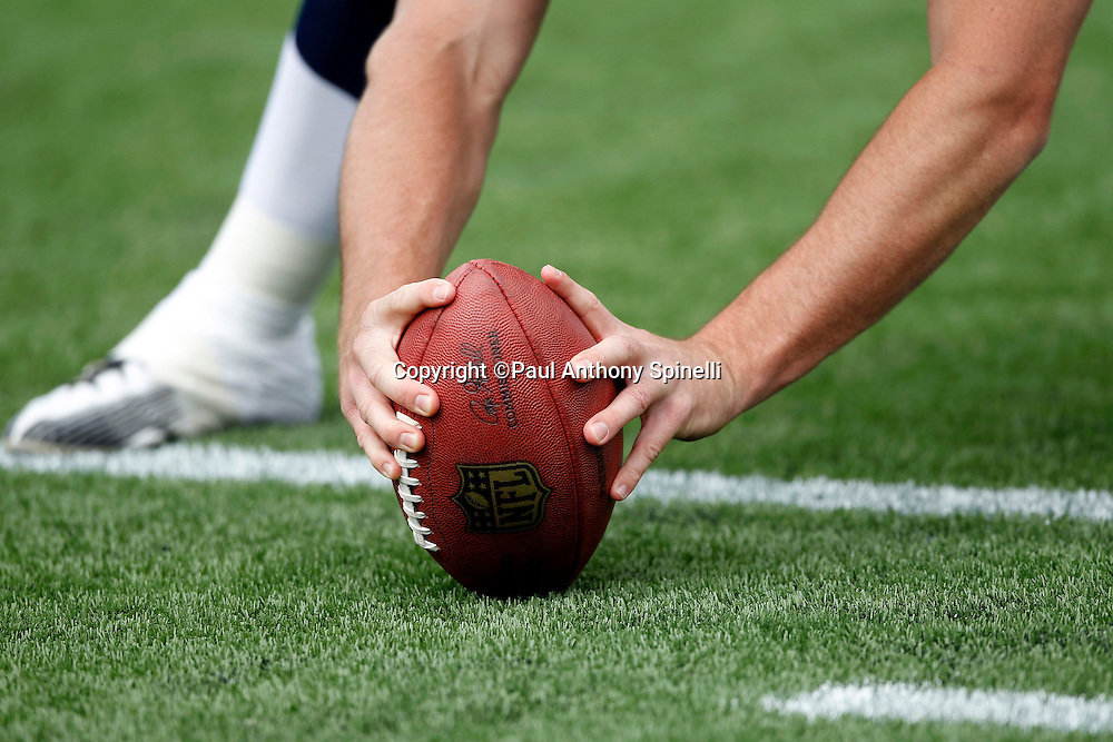 A player gets ready to snap the ball at the New England Patriots NFL regular season week 3 football game against the Buffalo Bills on September 26, 2010 in Foxborough, Massachusetts. The Patriots won the game 38-30. (©Paul Anthony Spinelli)