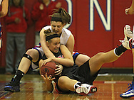 Washington Warrior's Abby Herb (2) and Linn-Mar Lion's Alexis Libenguth (43) battle for a lose ball during their Regional Semi-Final game at Washington High School in Cedar Rapids on Saturday, February 16 2013.