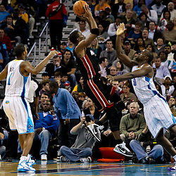 November 5, 2010; New Orleans, LA, USA; Miami Heat power forward Chris Bosh (1) shoots over New Orleans Hornets center Emeka Okafor (50) during a game at the New Orleans Arena. The Hornets defeated the Heat 96-93. Mandatory Credit: Derick E. Hingle