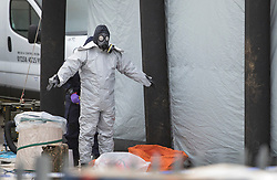 © Licensed to London News Pictures. 15/03/2018. Alderholt, UK. Police in protective overalls and a gas masks start to remove their protective overalls at Ashley Wood Recovery in Salisbury where the car belonging to former Russian spy Sergei Skripal was taken after he and his daughter Yulia were poisoned with nerve agent. The couple where found unconscious on bench in Salisbury shopping centre. A policeman who went to their aid is currently recovering in hospital. Photo credit: Peter Macdiarmid/LNP
