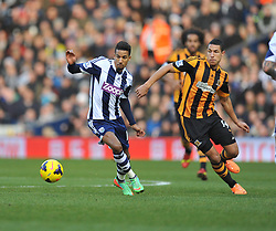 West Bromwich Albion's Scott Sinclair looks to play the ball under pressure from Hull City's Jake Livermore - Photo mandatory by-line: Alex James/JMP - Tel: Mobile: 07966 386802 21/12/2013 - SPORT - FOOTBALL - The Hawthorns - West Bromwich - West Brom v Hull City - Barclays Premier League