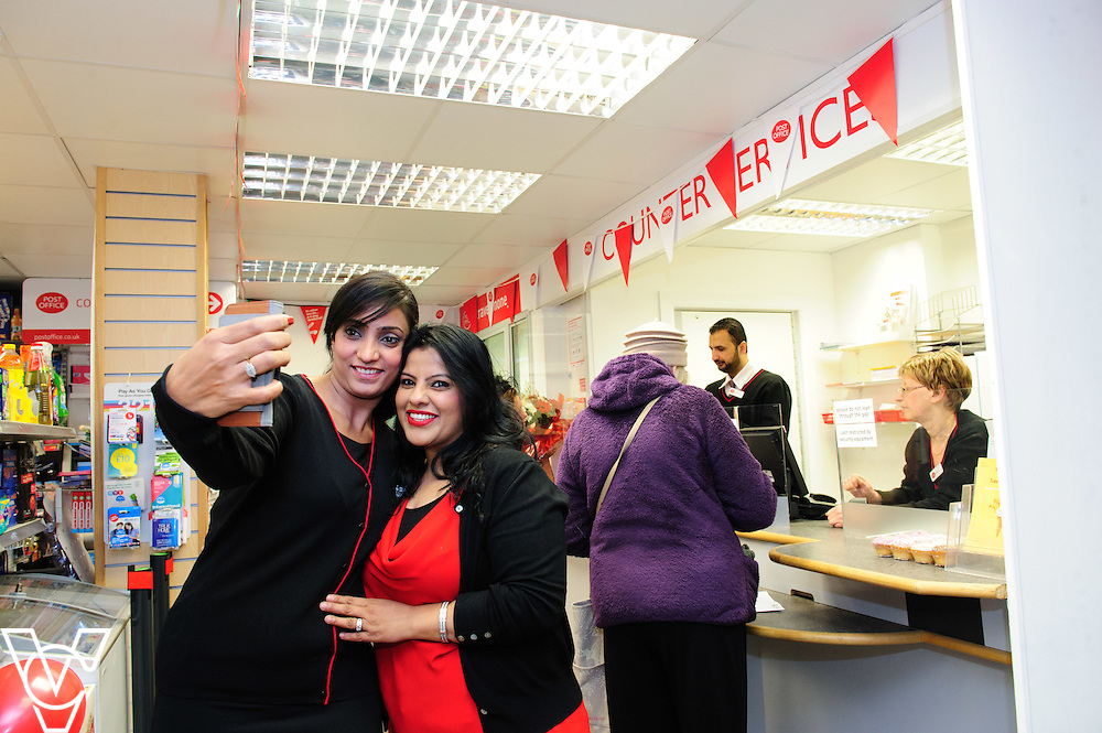 Pictured is Parmjit Kavr, left, and Mandy Kavr taking a selfie during the opening.<br /> <br /> The Mayor of Melton Jeanne Douglas has officially opened the new Post Office in Melton Mowbray.<br /> <br /> Date: March 16, 2016