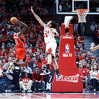 10 May 2011: Atlanta Hawks guard Jamal Crawford (11) takes a jump shot over Chicago Bulls center Joakim Noah (13) during the Chicago Bulls 95-83 victory over the Atlanta Hawks, during game 5 of the Eastern Conference semi finals at the United Center, Chicago, Illinois, USA.