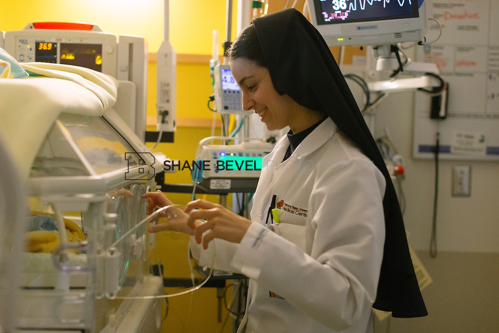 9/29/16 9:22:41 AM --  Sister Mary on rotation at The Children's Hospital NICU. <br /> <br /> Photo by Shane Bevel