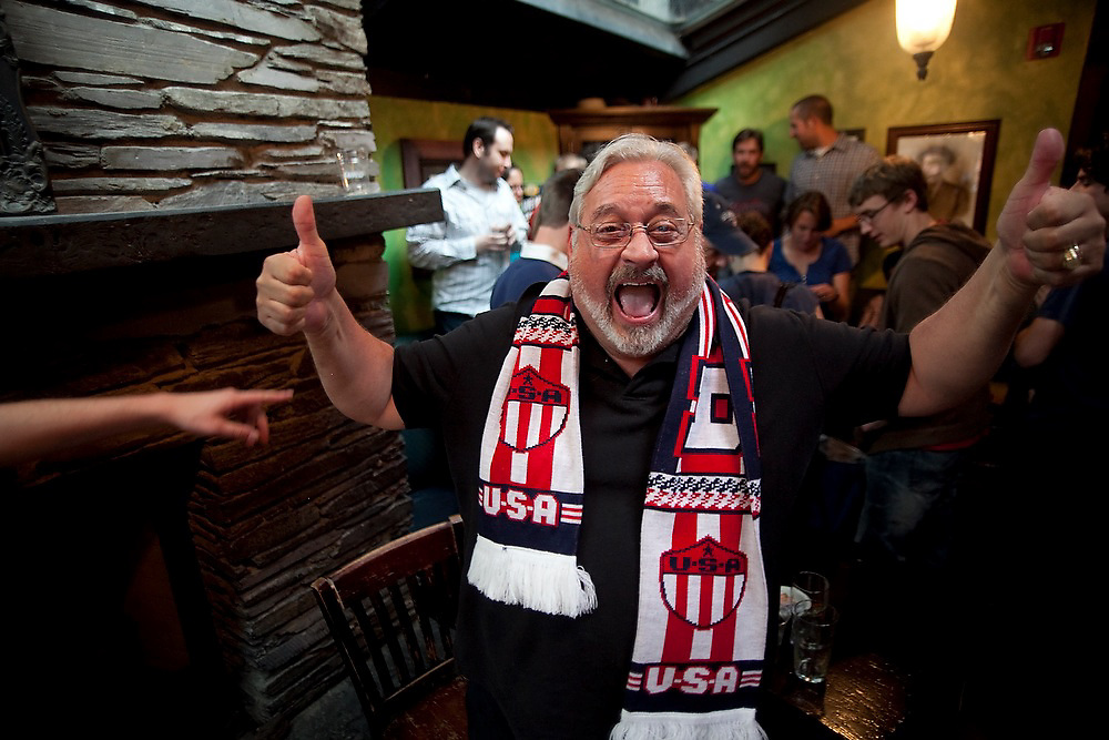 A fan for the US celebrates the outcome (1-1 tie) of the World Cup soccer match between England and the USA at Conor O'Neill's pub in Boulder, Colorado on June 12, 2010.