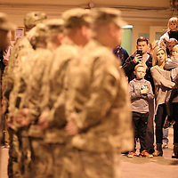Family and friends look on as members the 155th HHC prepare to leave Tuesday morning from Tupelo to go to Fort Bliss for training before they deploy to the Middle East.
