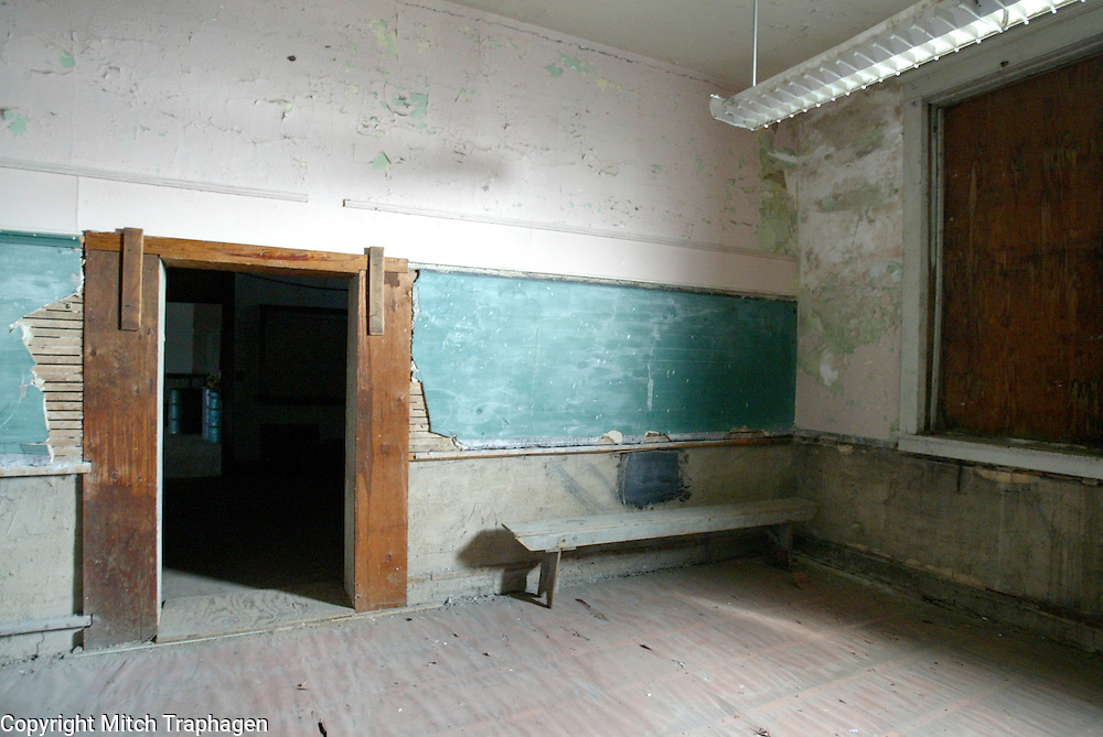 A class room in a 100-year-old school building in Andover, South Dakota.  The school has been closed for nearly 50 years.