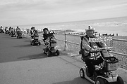 Brian Giles leads Grand Parade of mobility scooters, Bexhill wheel and walk mobility carriages. Proceeds to Bexhill Caring Community. 16 September 2018