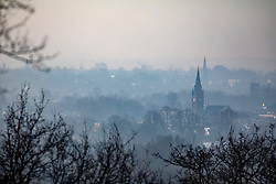 © Licensed to London News Pictures. 07/02/2020. London, UK. Calm before the storm. Church steeples in the mist from Richmond Park this morning as weather experts predict stormy weather with high winds and heavy rain for the weekend. Photo credit: Alex Lentati/LNP