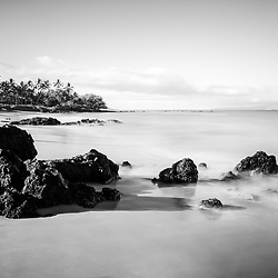 Mōkapu Beach black and white photo in Wailea Makena Maui Hawaii with lava rocks and the Pacific Ocean. Copyright ⓒ 2019 Paul Velgos with All Rights Reserved.